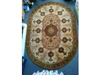Stunning large vintage oval rug in as new condition. 242cm x 171cm