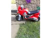 Red plastic motorbike.