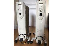 Pair of freestanding electric oil-filled radiators