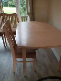 Table and 4 chairs FREE.