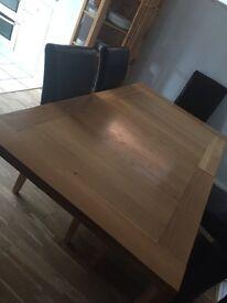 Extending oak dining table.