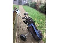 Set of golf clubs and buggy