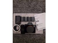 Sony a7s Inc 4 batteries and sony to canon lens adapter