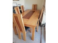Solid oak dinning table with 6 leather top chairs