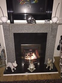 Polished granite full fireplace with gas fire