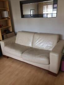 Three seater leather sofa bed by dfs