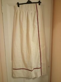 White, lined curtains with burgundy trim