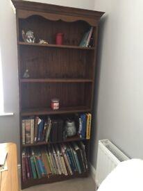 Tall solid wood dark brown shelf unit. 5 shelves