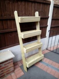 step ladder style wooden planter