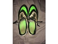 Black green and white hypervenom boots