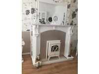 Fireplace for sale comes with fire! Surround part is only wallpaper can be peeled of