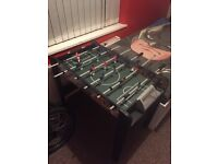 Football table, missing some handles but doesn't affect the play, in good condition