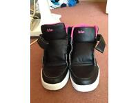 Pink and black trainers