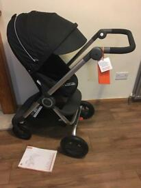 Brand new Stokke scoot v2 in black or red RRP £529