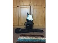 3/4 fender squier guitar, amp and carrying case