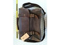 Brand new Kattee briefcase. Brown canvas with leather details. Carry handle and shoulder strap.