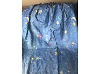 Blue lined curtains with space theme