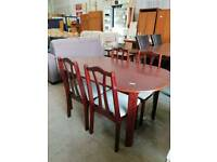Cherry red dining table with four chairs available