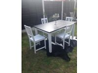 Solid mixed timber dining table and chairs