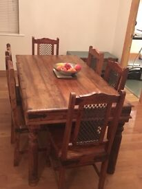 Dining table and six chairs - dark wood with black metal finishings