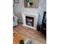 Electric Fireplace Suite for sale. Cream surround, black backplate, brushed stainless steel heater.