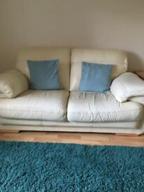 Cream leather two seater sofa and armchairbought from Fenwick and in reasonable condition