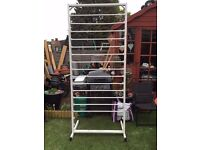 a large floristry cellophane roll holder comes in pieces for easy transportation