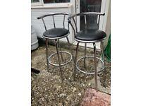 Pair of chrome based bar stools