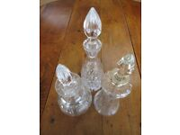 3 Cut Glass Wine decanters, including 1 vintage glass decanter with silver detail to neck