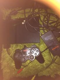 For sale one ps 2 plus 10 games