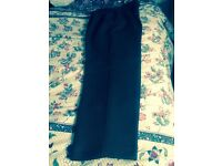A pair of Brown small Snapchat trousers size 12