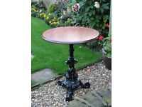 Vintage cast iron table base with veneer wooden Top
