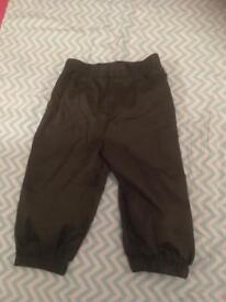 2 pairs of Baby showerproof trousers