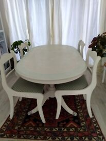 Painted dining table and 4 chairs.