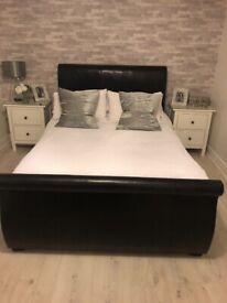 Black leather scroll end double bed frame with storage