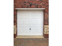 Electric up and over white garage door (Hormann), with 2 remote fobs