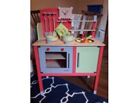 Wooden toy kitchen and table
