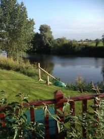 Riverside Holiday Home with fantastic views of river, sleeps 6, gas C/H, private mooring, heavenly!