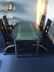 Glass Dining Table & 6 chairs - good as new! Table extends