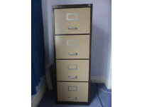 METAL FILING CABINET with four drawers.
