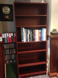 Dark wood bookcase with 5 shelves 2 of which are adjustable