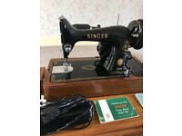 1955 99K Singer sewing machine with electic light, foot control, extension, case, key, booklets, pad