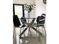 Gorgeous round glass dining table