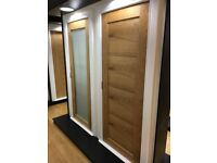 Half price sale on pre finished oak shaker bow doors