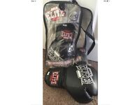Elite MMA sparring gloves with attached thumbs And wrap kit used few times,wraps new in packaging