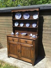 Lovely vintage Welsh dresser with linen fold carving to doors. Probably Ercol or Ducal.