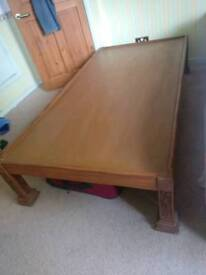 Single wooden bed in good condition
