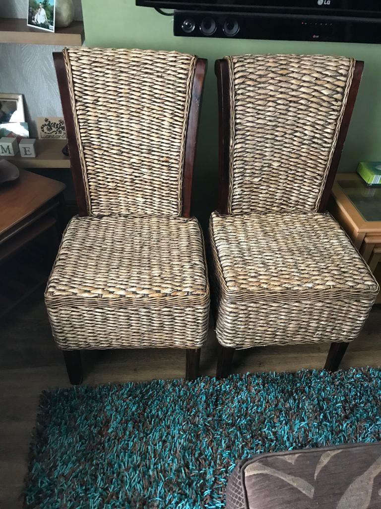 Two Quality solid wood rattan chairs