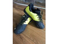 Used boys Babolat tennis shoes- black and yellow- size 5