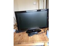 19in TV with stand, not original remote but have a universal one.